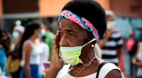 Una mujer llora en una ceremonia religiosa en Caracas.
