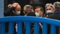 Expertos de la Organización Mundial de la Salud (OMS), que investigan el origen del coronavirus Covid-19, visitan el mercado mayorista cerrado de Wuhan.