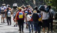 Gran cantidad de venezolanos han llegado a países suramericanos en los últimos días ante la agudización de la crisis social, económica y política en el país gobernado por Nicolás Maduro. Foto: referencial/AFP