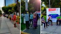 Alrededor del parque se viene realizando largas colas no solo de adultos mayores, sino también de personas con alguna discapacidad que buscan alguna sombra o silla para poder esperar mientas se instalan las mesas.
