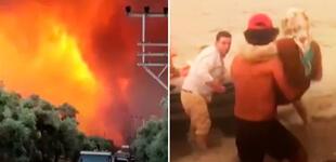 """Más de 120 incendios forestales obligan a pobladores y a turistas a huir en botes: """"Es un infierno"""""""