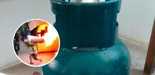 Bombero carga un balón de gas en llamas para evitar que explotara en un restaurante [VIDEO]