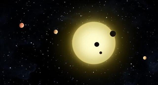 Representación artística de Kepler-11, estrella pequeña y fría alrededor de la cual orbitan seis planetas   Foto: NASA/Tim Pyle