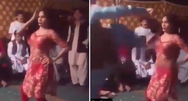Mujer recibe terrible patada por bailar en la vía pública.