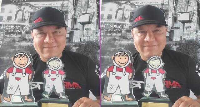 Mauricio Diez Canseco recibe reconocimiento por apoyo a niños.